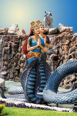 Krishna dancing on the head of the serpent Kaliya with Kaliya photo