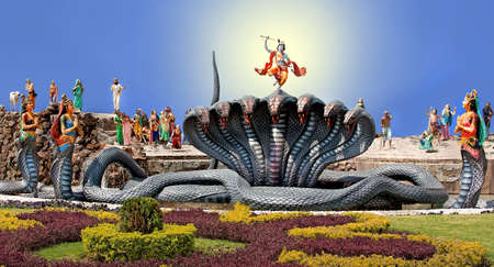 Krishna dancing on the head of the serpent Kaliya with Kaliya Standard-Bild