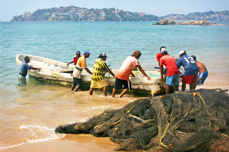 fishermans net: Mexican fishermen with boat and nets