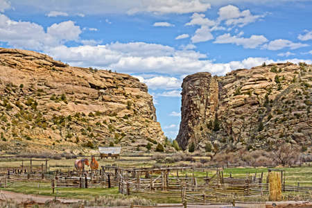 A landmark to the pioneers moving west in their wagons with a ranch in the foreground photo
