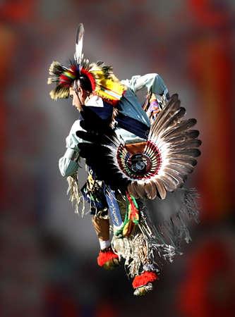 a Native American in full regalia doing a war dance
