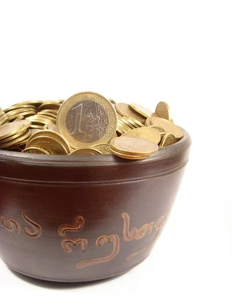 bowl full of polish and euro coins photo
