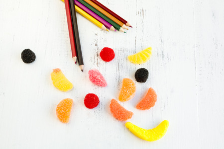 Sweets and colored pencils photo
