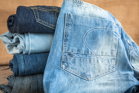 blue  jeans: Blue jeans on wooden table Stock Photo