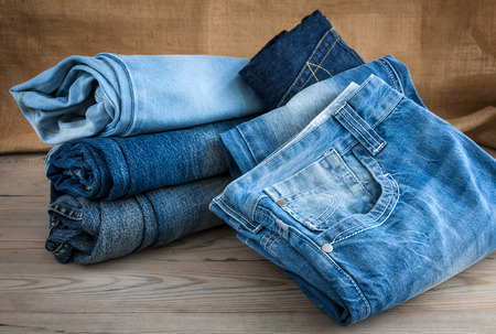 Blue jeans on wooden table Stock Photo