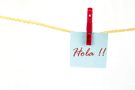 note paper: Note paper with the written word hola