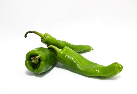 Green peppers isolated on white background Banco de Imagens