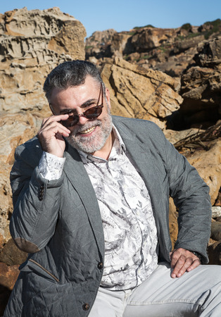 rock bottom: Portrait of attractive man with a beard and sunglasses rock bottom Stock Photo