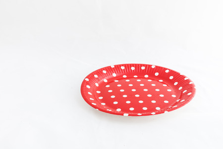 moles: Spanish dishes with red polka dots on wooden table