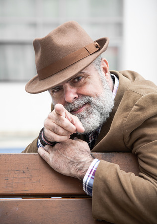 enticement: Attractive man 50 years old with beard and hat