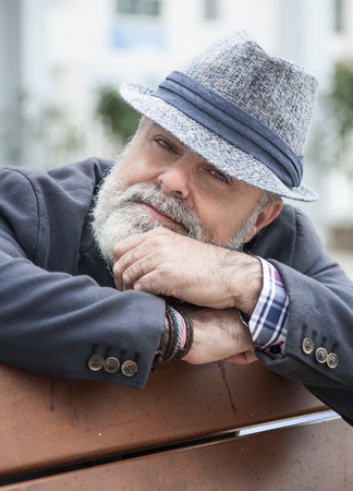 50 years old: Attractive man 50 years old with beard and hat