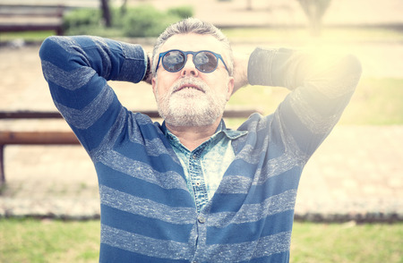 50 years old: Attractive man 50 years old with beard and sanglasses