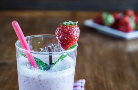 non alcoholic: Fresh strawberry milkshake on old wooden table Stock Photo
