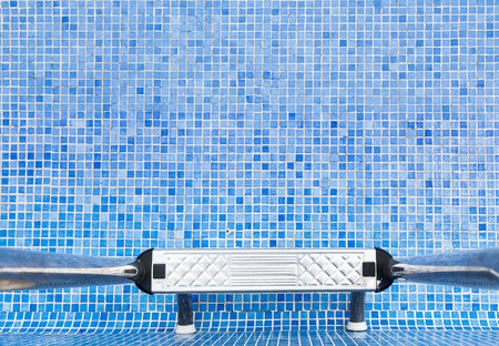 An empty swimming pool with blue tiles Stock Photo