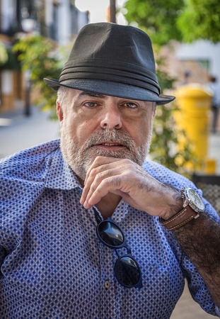 conceited: Attractive man 50 years old with beard and hat