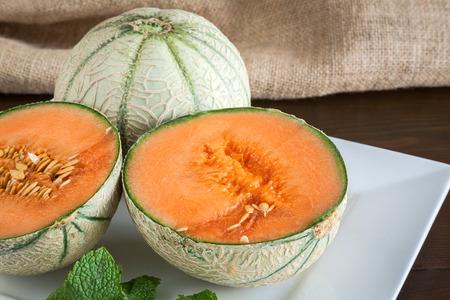 cantaloupe: Cantaloupe Melons on wood Stock Photo