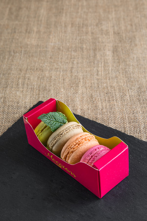 beautifull: traditional french colorfu beautifull macarons in a rows in a box Stock Photo