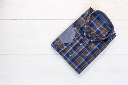 elbow pads: Modern plaid shirt with elbow patches on white table Stock Photo