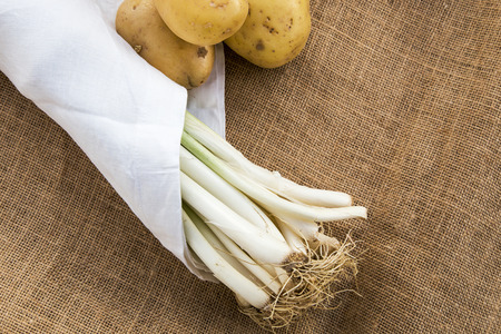 leeks: Potatoes and leeks with white napkin fabric sack