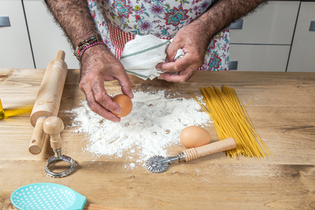 short pasta: Male chef making spaghetti in a modern kitchen