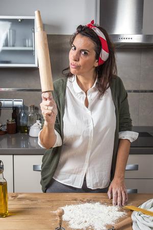 short pasta: Woman chef making spaghetti in a modern kitchen