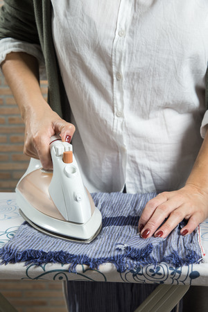 woman ironing: Middle-aged woman ironing in the kitchen