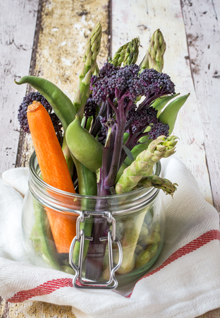 fresh vegetables: Healthy eating fresh vegetables on wood and glass bottle Stock Photo