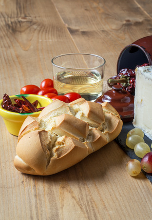 intense flavor: Typical Spanish Manchego cheese with grapes,mint and rosemary,bread and chili