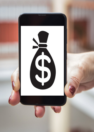 signo pesos: Mobile concept dollar sign: Woman hands with dollar sign in the mobile phone screen