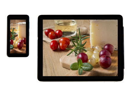 typical: Photo typical Spanish Manchego cheese with grapes on tablet indoors