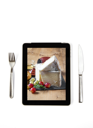 intense flavor: typical Spanish Manchego cheese with grapes on tablet indoors