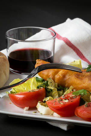 greenery: Fish sandwich with greenery, tomatoes and salad on plate Stock Photo