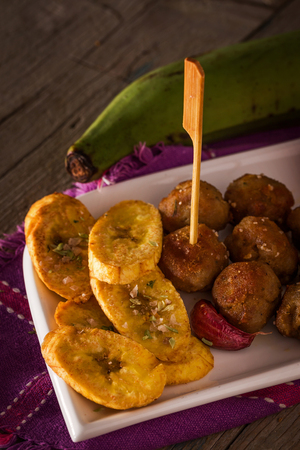 meatloaf: Meatloaf with fried plantains, bread and wine