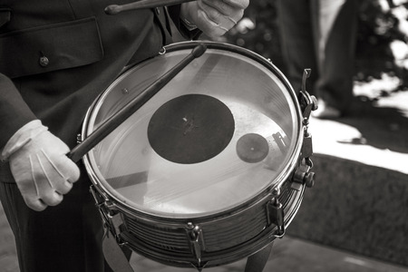 marching: Unrecognizable man marching while playing drum