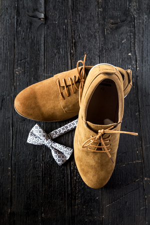 New mens shoes on white wooden floor