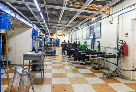 launderette: Tangier, Morocco-April 18,2016:In the picture we can see an industrial laundry with workers, washing machine, dryers, laboratory and boilers.