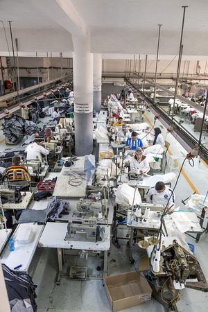 machinist: April 18,2016.TANGIER, MOROCCO:  clothing company manufactures industrial sewing machines and skilled,textile factory production machinist working in line