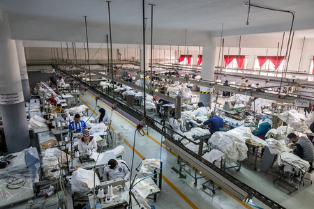 textile industry: April 18,2016.TANGIER, MOROCCO:  clothing company manufactures industrial sewing machines and skilled,textile factory production machinist working in line