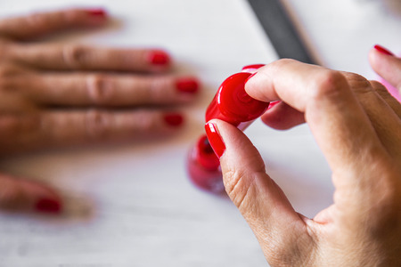 cosmetic lacquer: Manicure - Beauty treatment photo of nice woman manicured fingernails. Selective focus.