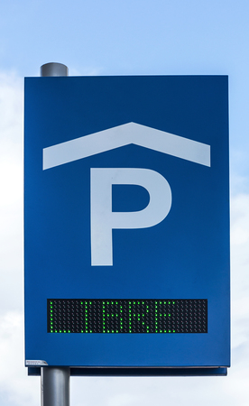 frei: A Free road sign for a parking area in blue sky Stock Photo