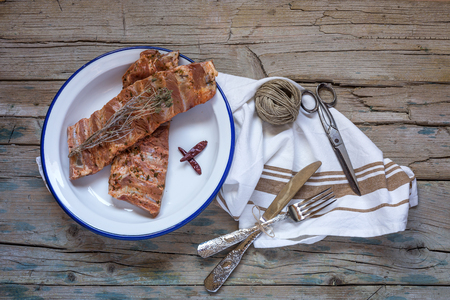 pork ribs: Raw pork ribs on the old wooden table with butcher knife Stock Photo