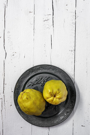 quinces: Fresh quinces on wooden table with napkin