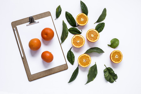 vitamines: Clipboard with an fresh oranges  isolated