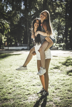 Lesbian Couple Together Outdoors Concept in a park Stock Photo