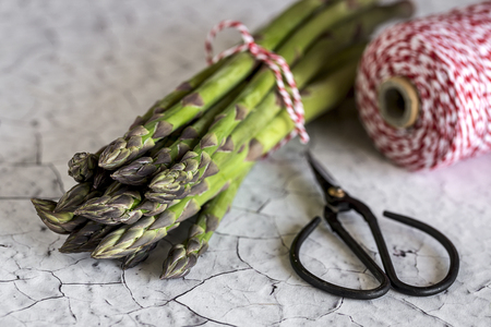 escarola: Fresh green asparagus on white wooden table.Detox