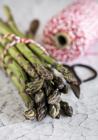 Fresh green asparagus on white wooden table.Detox