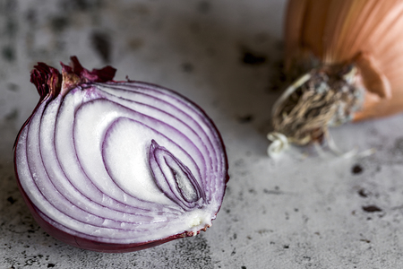 Fresh onions on old black wood table.Detox Stock Photo