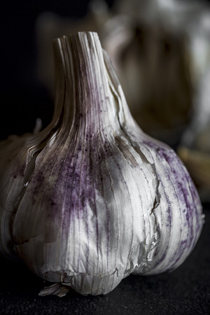 Fresh garlic on old black wood table.Detox Stock Photo