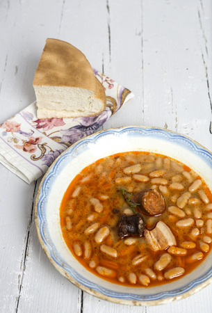 Stew of beans with sausage and pork. Typical Spanish food. With spicy chillies