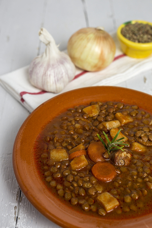 upholstered: Stew of lentils with sausage and pork. Typical Spanish food. With spicy chillies